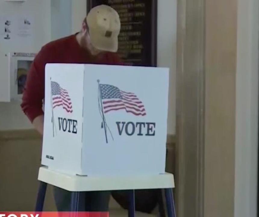 Voter casting a ballot