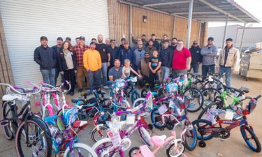 Members of UA Local 114 stand with bikes built with Chumash foundatin.