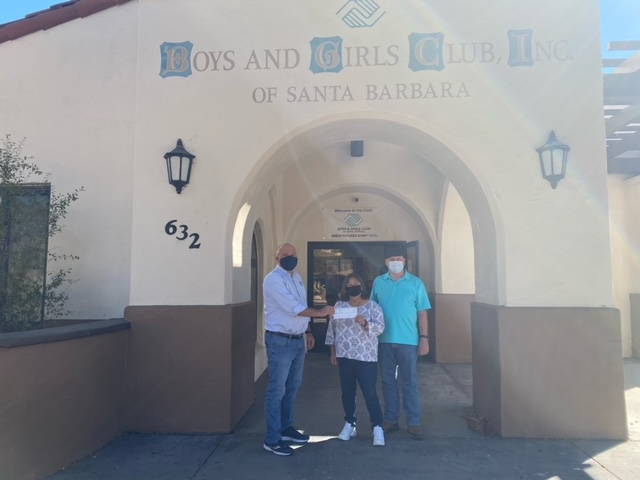 Susan Berry receiving prize money from the United Boys & Girls Clubs of Santa Barbara County