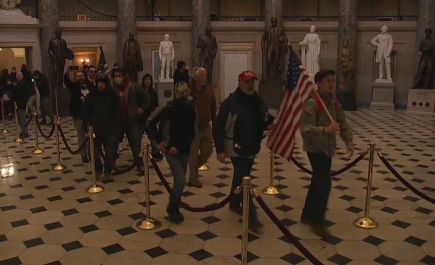 Rioters walk through Statuary Hall