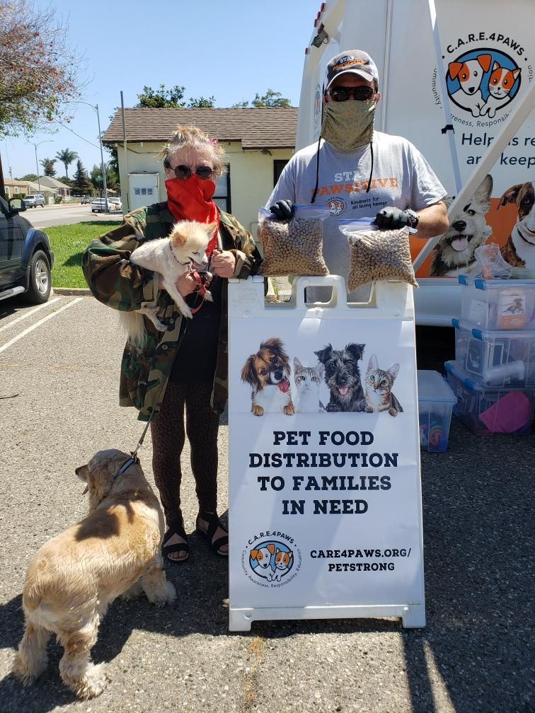 Pet Food Distribution at C.A.R.E.4Paws' Mobile Clinic with Clinic Manager & Cofounder Carlos Abitia - Courtesy Photo