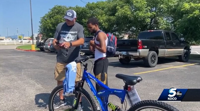 <i>KOCO</i><br/>Michael Lynn (left) stands next to Donte Franklin and his new bicycle. The biker charity group My Riding Buddies Oklahoma and Bikers for Elves gave Franklin the bike after they saw Lynn's facebook post about Franklin's daily 17-mile walk to work.