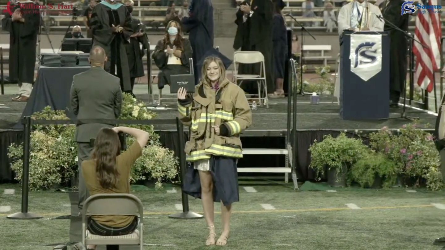 Joslyn Carlon received her diploma while wearing her late father's firefighting jacket.