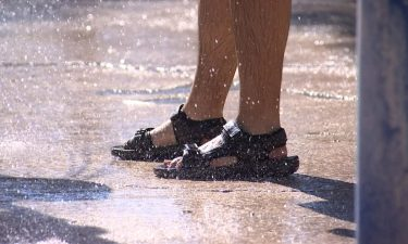 Doctors recommend wearing thick soled shoes for protection from the intense heat.