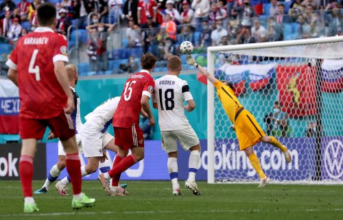 Aleksei Miranchuk of Russia scores their side's winner against Finland.
