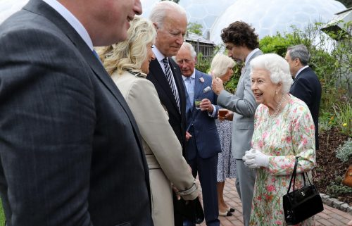 Britain's Queen Elizabeth II speaks with US President Joe Biden and US First Lady Jill Biden and leaders of the G7 during a reception at The Eden Project in south west England on June 11.