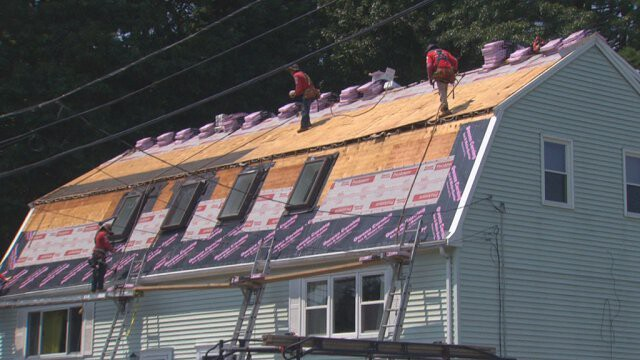<i>WBZ</i><br/>Workers put a new roof on Admira Depina's roof in Randolph.