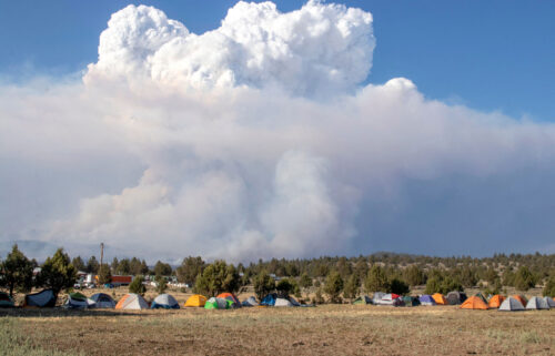 A pyrocumulus cloud caused by the Bootleg Fire drifts north of a firefighter operating base in Bly