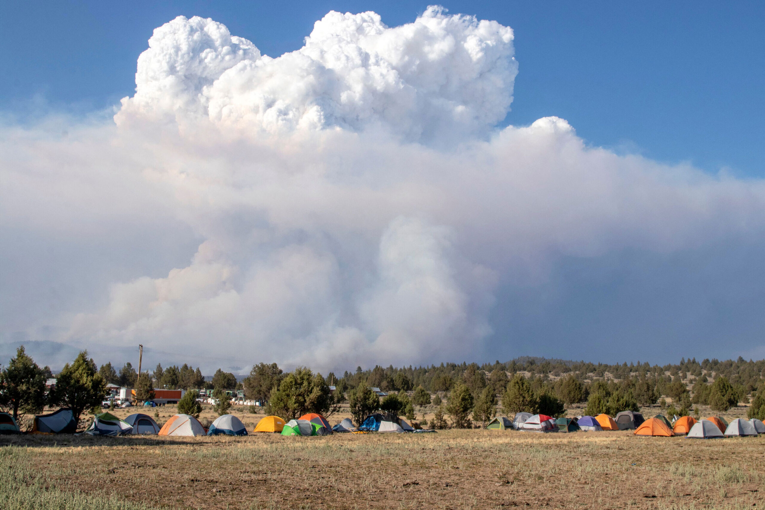 <i>Payton Bruni/AFP/Getty Images</i><br/>A pyrocumulus cloud caused by the Bootleg Fire drifts north of a firefighter operating base in Bly