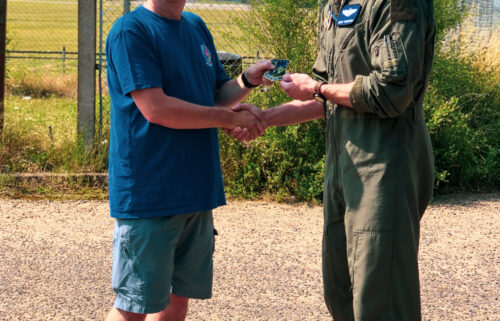 Photographer Ian Simpson meets fighter pilot Maj. Grant Thompson on July 20 after Simpson made a potentially lifesaving intervention when he spotted something wrong with Thompson's F-15E Strike Eagle fighter jet.