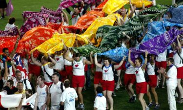 Participants from the United Kingdom team march onto the field during the opening ceremony of the 2002 Gay Games in Sydney