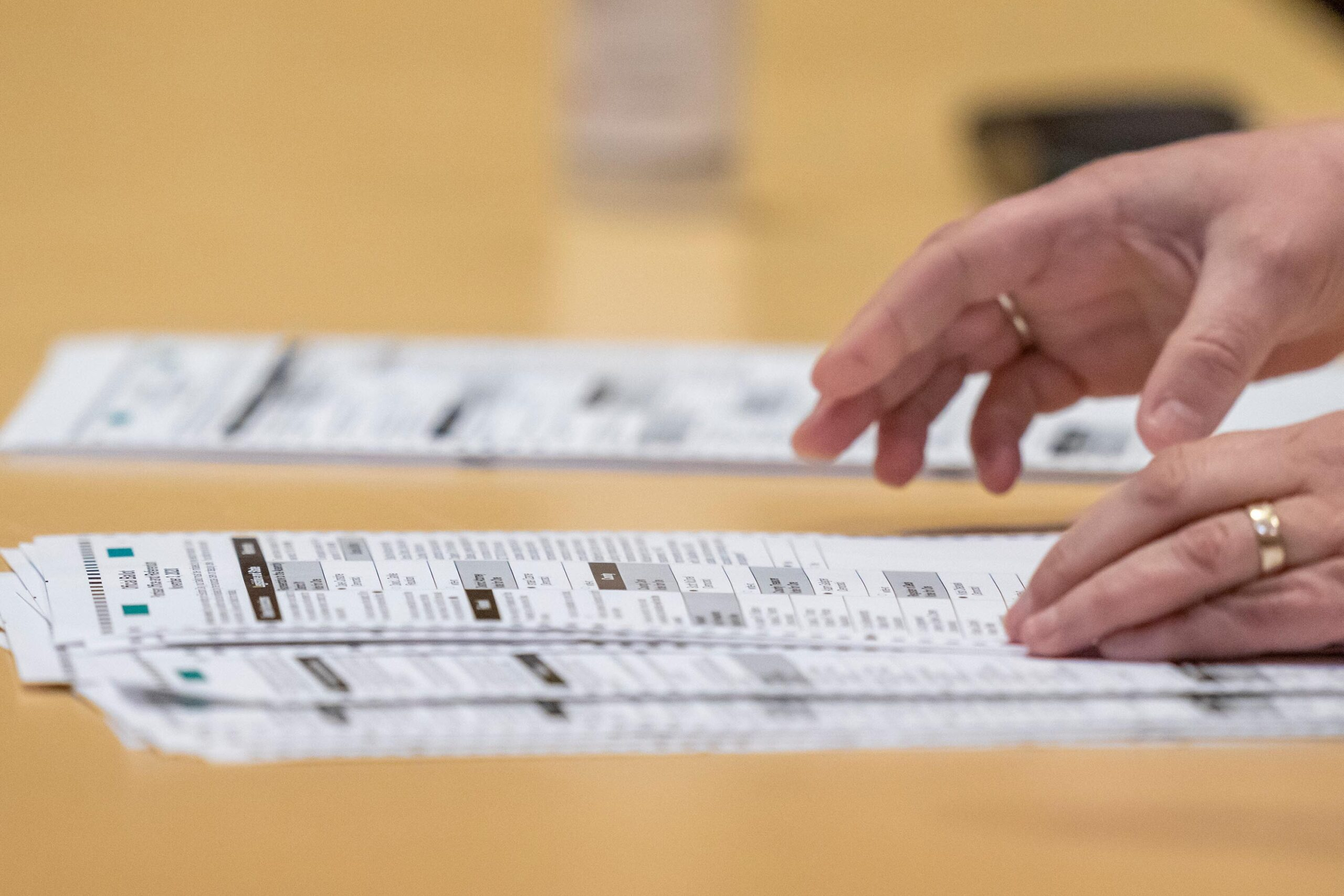 <i>Andy Manis/Getty Images</i><br/>An election worker shows ballots to representatives for President Donald Trump during the presidential recount vote for Dane County on November 20