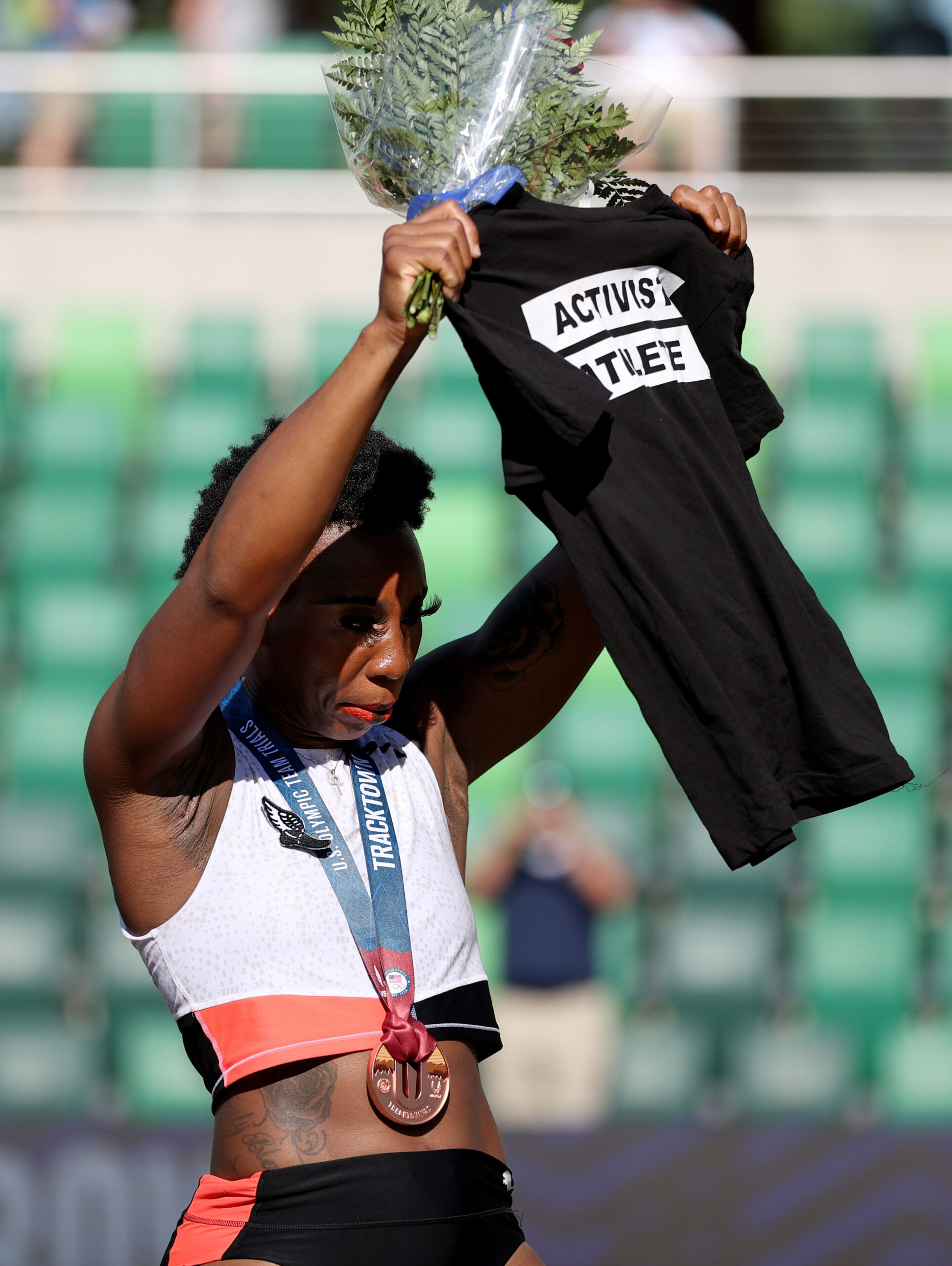 <i>Patrick Smith/Getty Images North America/Getty Images</i><br/>Gwen Berry holds up a shirt reading