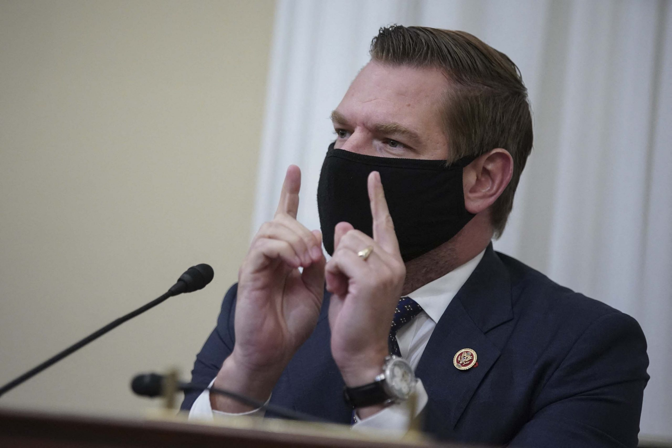 <i>AL DRAGO/POOL/AFP via Getty Images</i><br/>Rep. Eric Swalwell falsely said Mitch McConnell only got 'serious' about Covid-19 vaccines after stock market dip.