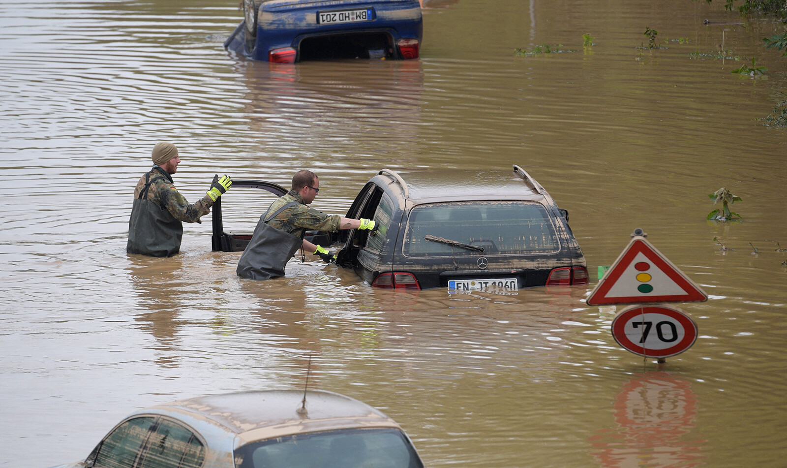 <i>Sebastien Bozon/AFP/Getty Images</i><br/>Soldiers of the German armed forces Bundeswehr search for flood victims in submerged vehicles on the federal highway B265 in Erftstadt