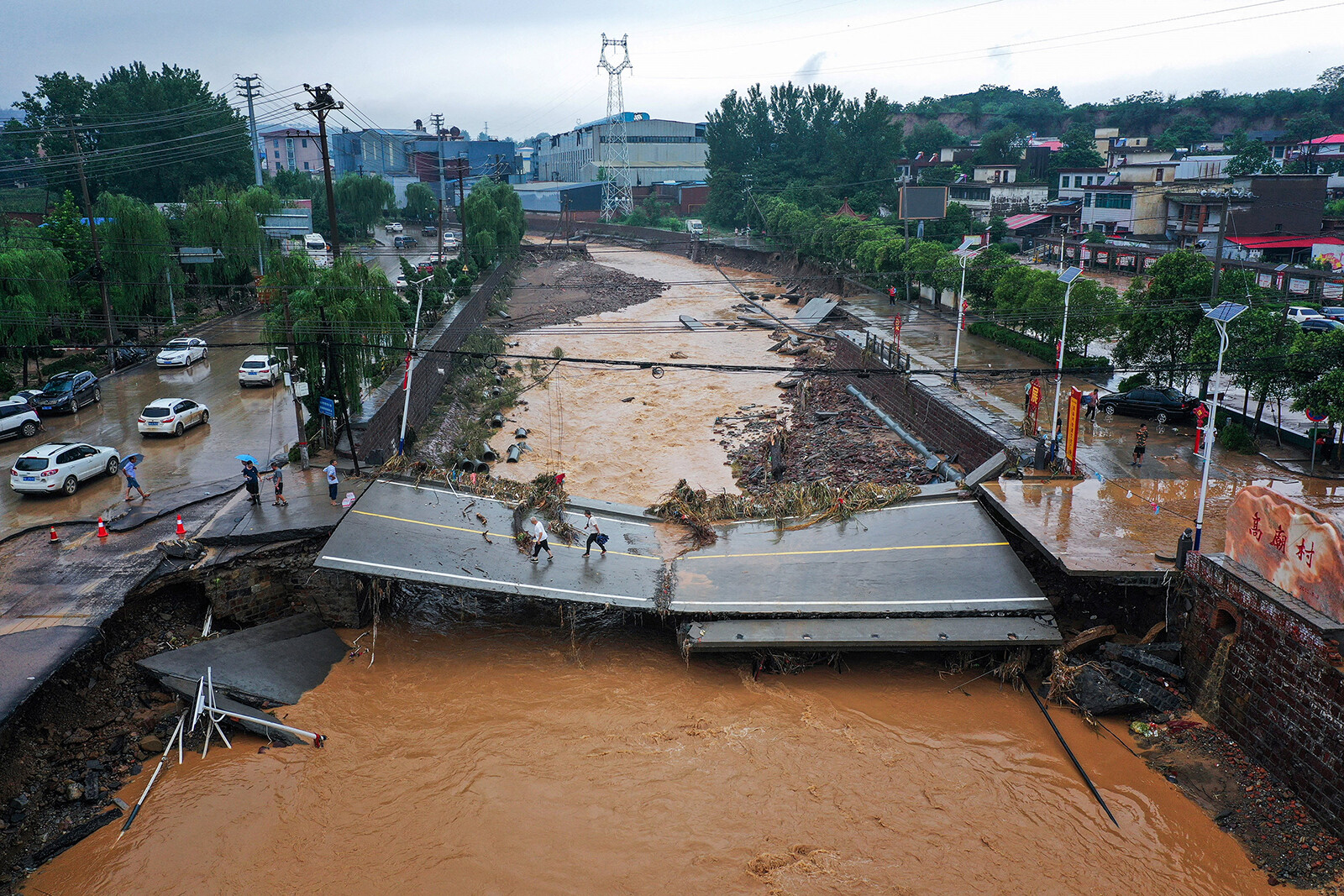 <i>STR/AFP/Getty Images</i><br/>A damaged bridge following heavy rains which caused severe flooding in Gongyi in China's central Henan province on July 21.