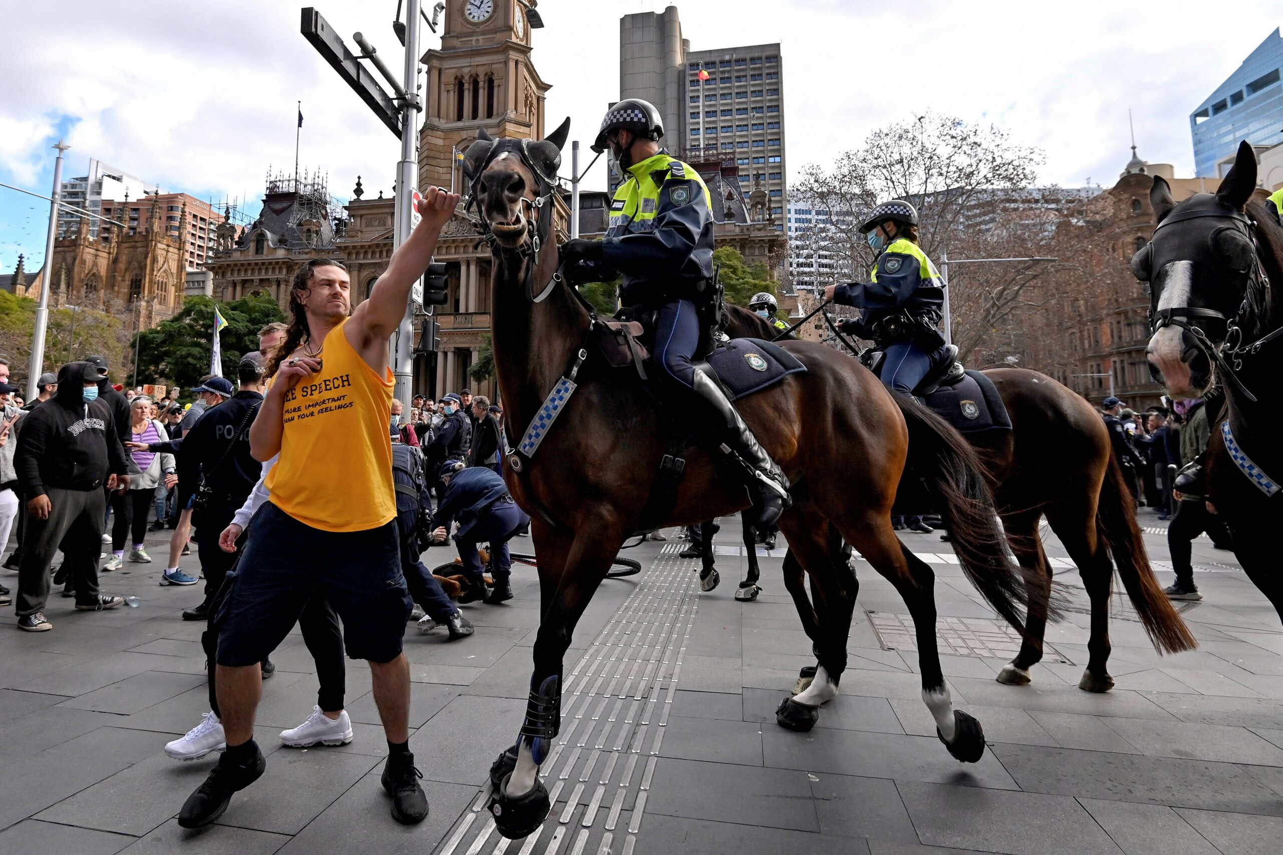 <i>Steven Saphore/AFP/Getty Images</i><br/>A protester tries to push away a police horse in Sydney on July 24