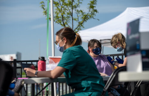 A nurse administers a shot of COVID-19 vaccine during a pop-up vaccination event at Lynn Family Stadium on April 26 in Louisville