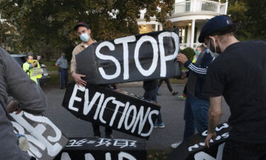 The White House announced Thursday that it would not ask the CDC to again extend the protection to ban evictions. Housing activists are shown erecting a sign in Swampscott