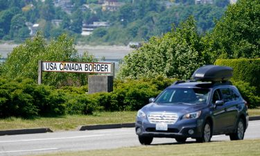 A car heads into the US from Canada at the Peace Arch border crossing on June 8