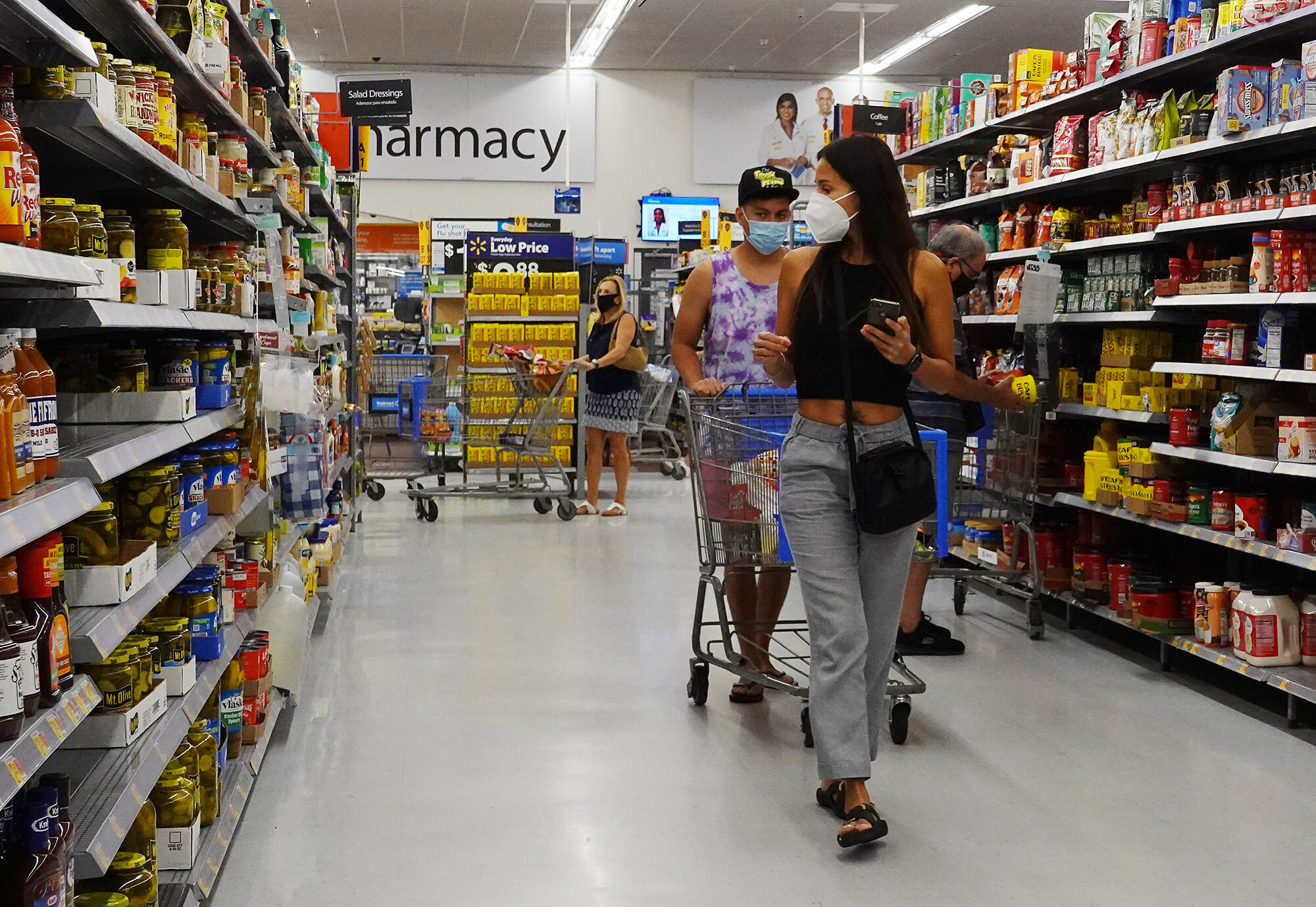 <i>Joe Raedle/Getty Images</i><br/>Walmart employees are required to wear masks inside again