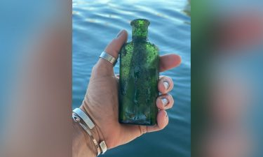 The bottle still had part of its cork inside and was about two-thirds full of water.