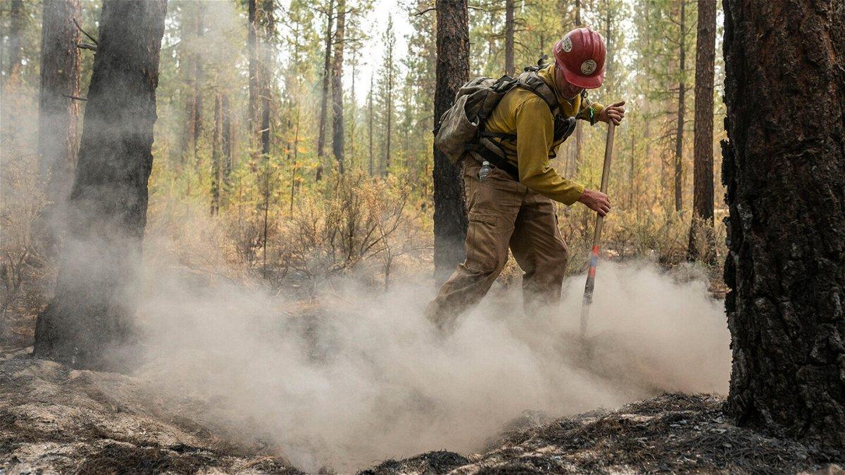 <i>Nathan Howard/AP</i><br/>Firefighter Garrett Suza