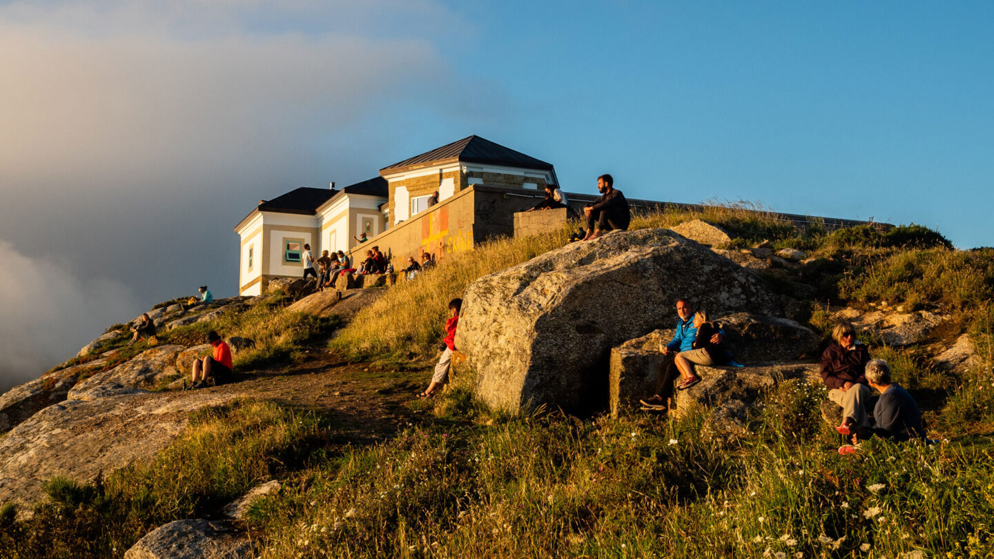<i>Ana Fernandez/SOPA Images/LightRocket/Getty Images</i><br/>Pilgrims and tourists are seen waiting for the sunset at the Cape Finisterre. Cape Finisterre is the destination of those pilgrims who