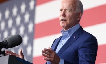 """President Joe Biden said Friday the wildfires intensifying in the West demand """"urgent action"""" as he met with seven governors to discuss how states are responding to the wildfires and how the federal government can best assist. Biden is shown during a campaign event for Terry McAuliffe"""