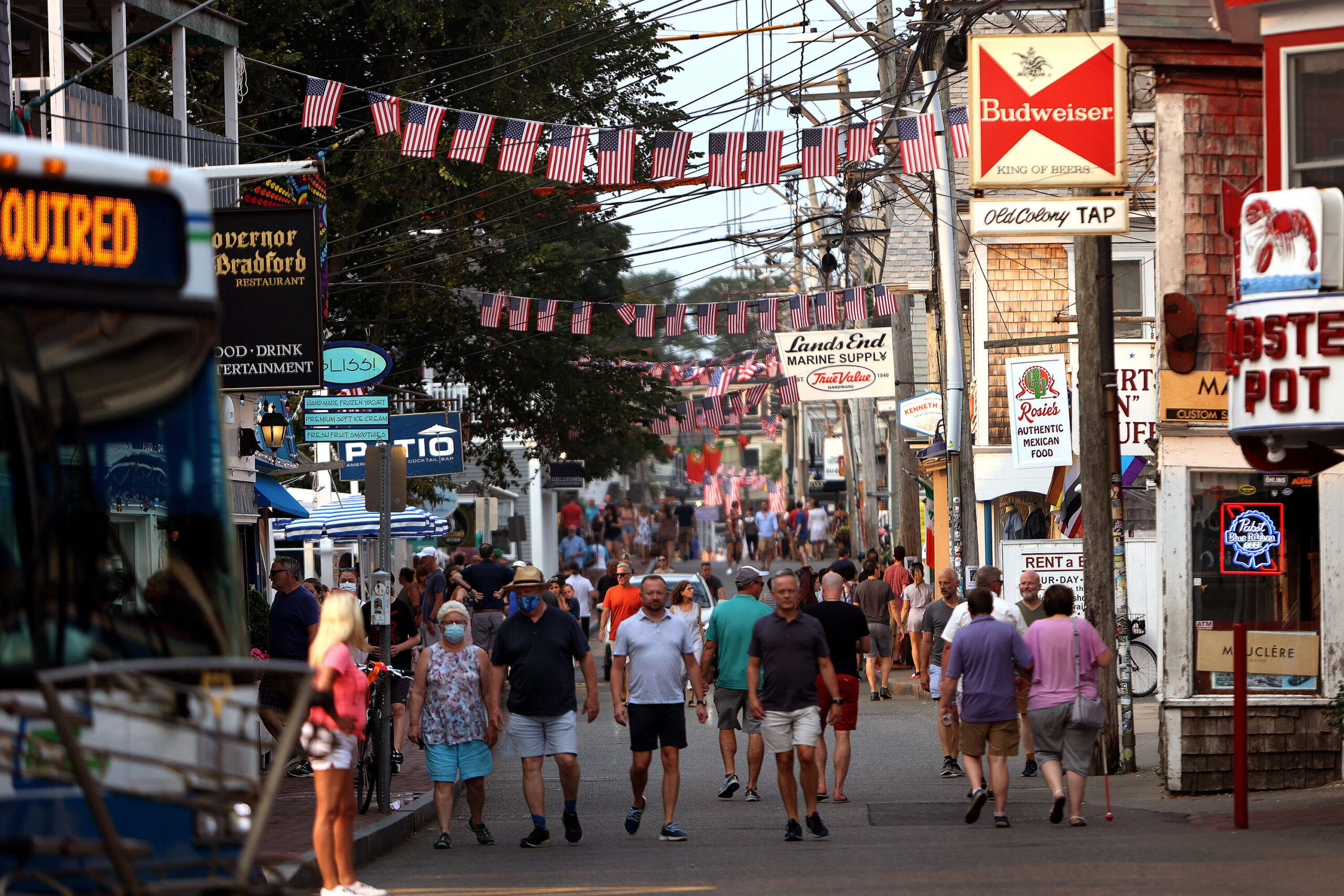 <i>Barry Chin/The Boston Globe/Getty Images</i><br/>A Covid-19 outbreak in Provincetown helped change the CDC's mask guidance. People walk down Commercial Street in Provincetown on Tuesday