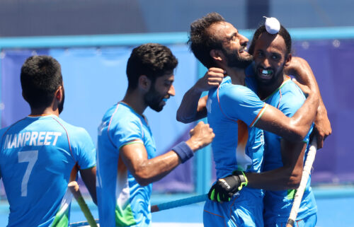 Harmanpreet Singh celebrates scoring their third goal with teammates during the men's bronze medal match.