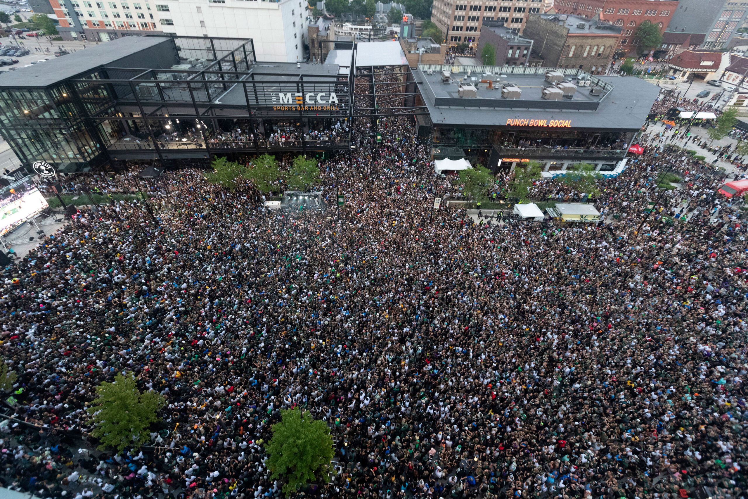 <i>Mark Hoffman/Milwaukee Journal Sentinel/USA Today Network</i><br/>Fans pack the Deer District during game six of the 2021 NBA Finals at Fiserv Forum on July 20.  Nearly 500 cases of Covid-19 have been reported following the event.