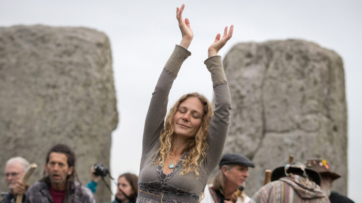 <i>Matt Cardy/Getty Images</i><br/>A woman dances as druids