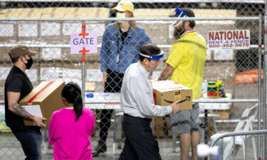 Former Secretary of State Ken Bennett works to move ballots from the 2020 general election at Veterans Memorial Coliseum on May 1