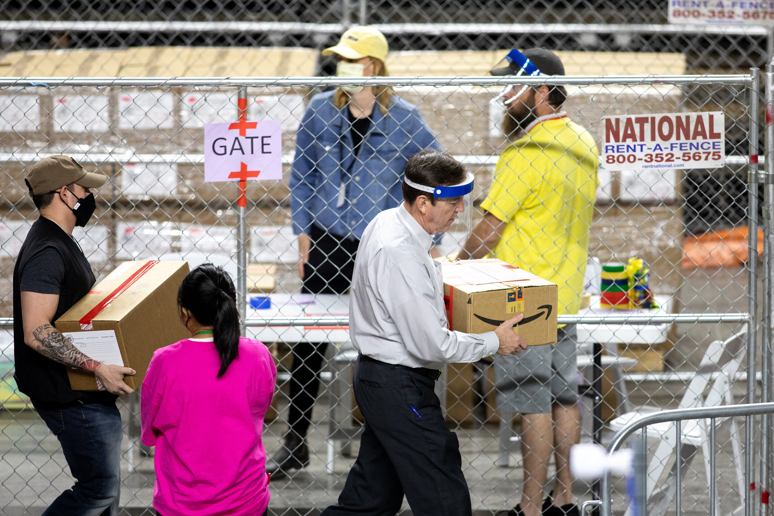 <i>Courtney Pedroza/Getty Images</i><br/>Former Secretary of State Ken Bennett works to move ballots from the 2020 general election at Veterans Memorial Coliseum on May 1