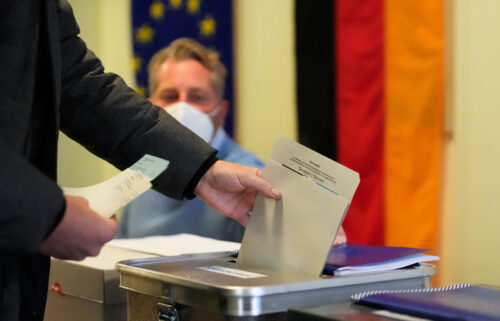 A man casts his vote in Germany's national parliamentary election at a polling station in Berlin