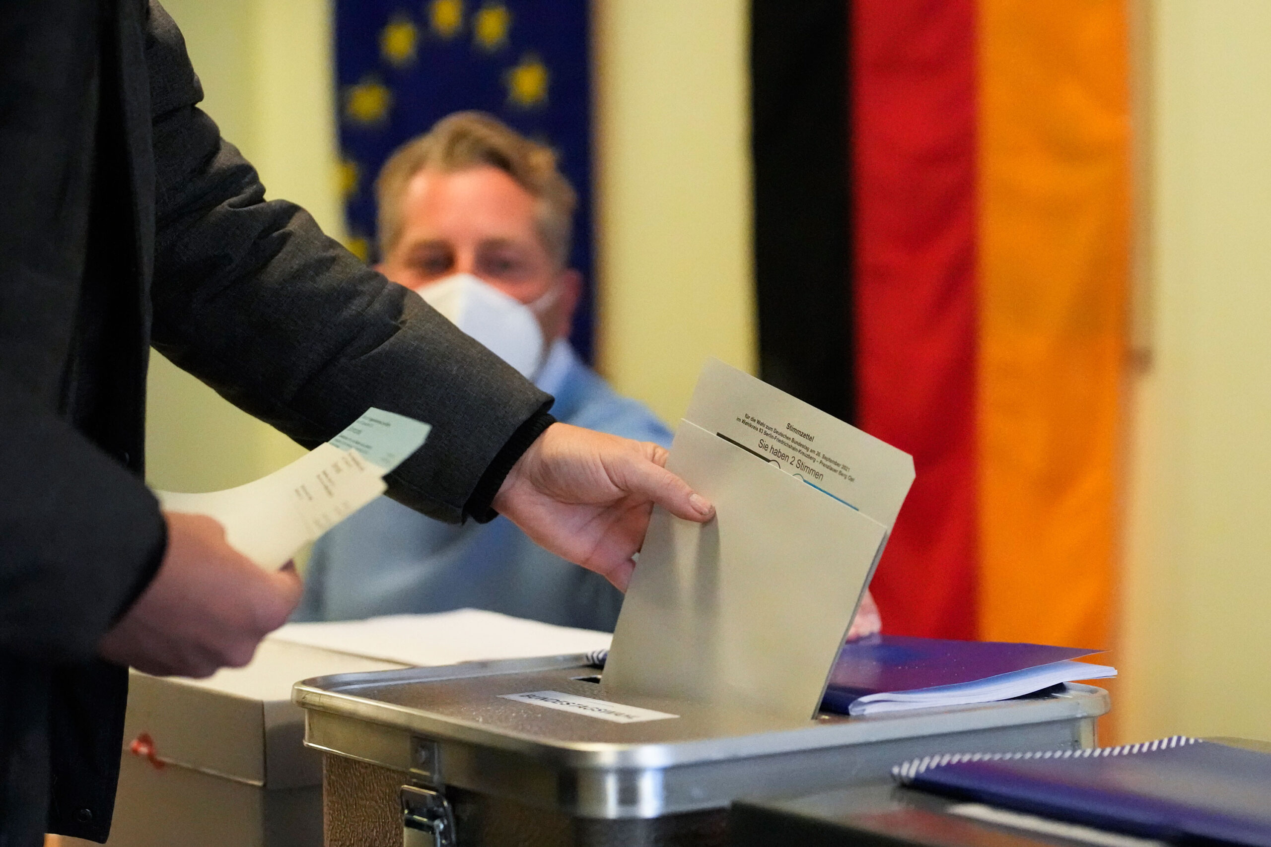 <i>Markus Schreiber/AP</i><br/>A man casts his vote in Germany's national parliamentary election at a polling station in Berlin