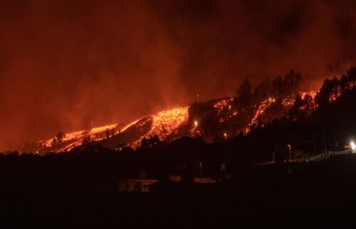 Lava flows approach houses as the Mount Cumbre Vieja erupts in El Paso