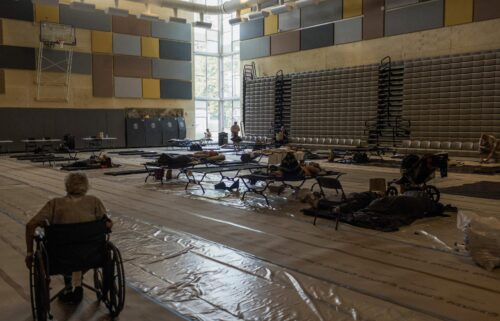 Residents spend the afternoon at a cooling center at Kellogg Middle School in Portland