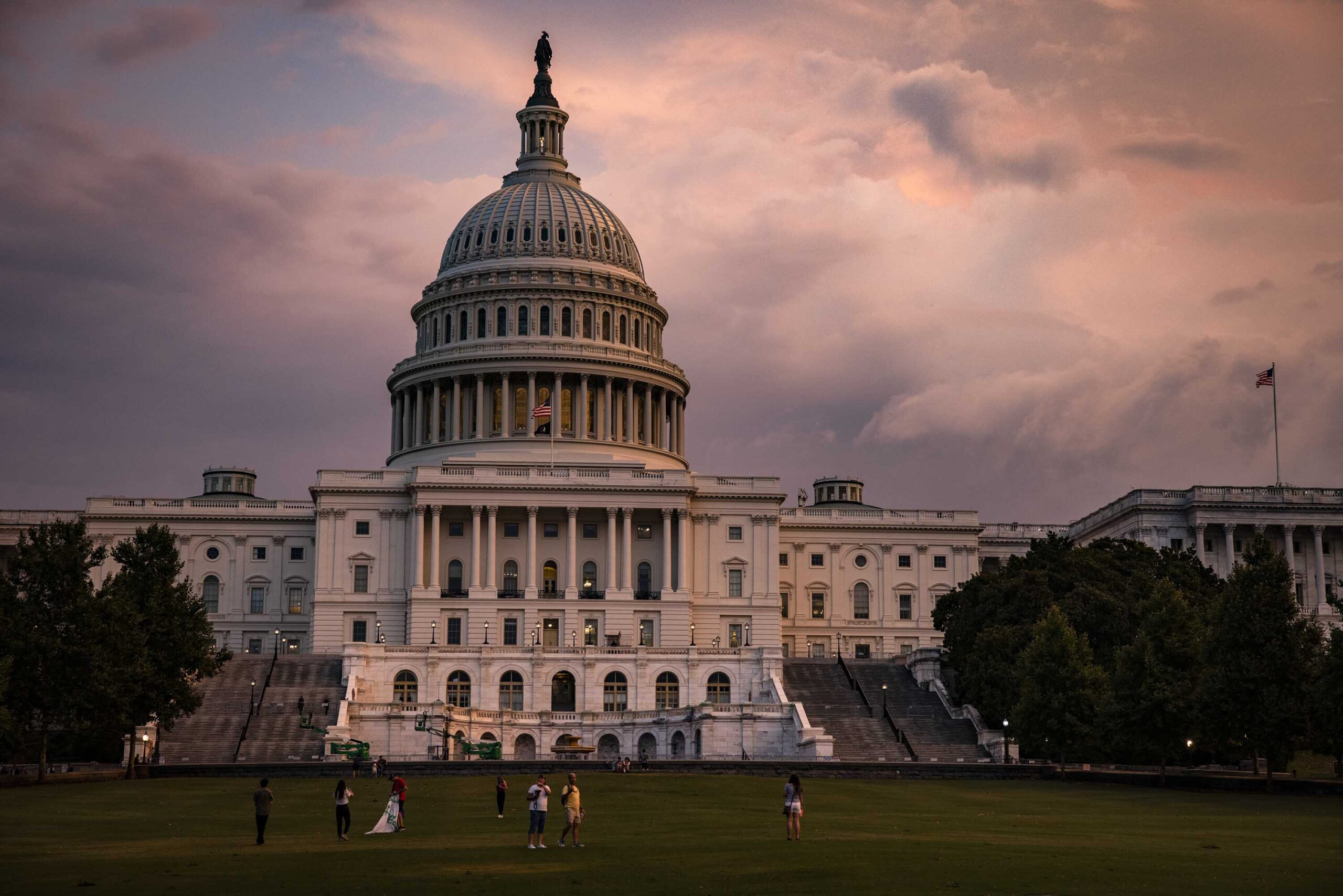<i>Samuel Corum/Getty Images</i><br/>The U.S. Capitol Building is seen as the sun sets on July 26