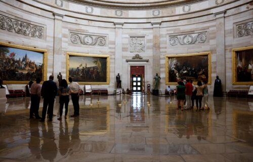 Staff members and interns admire the rotunda of the U.S. Capitol Building on August 6 in Washington.