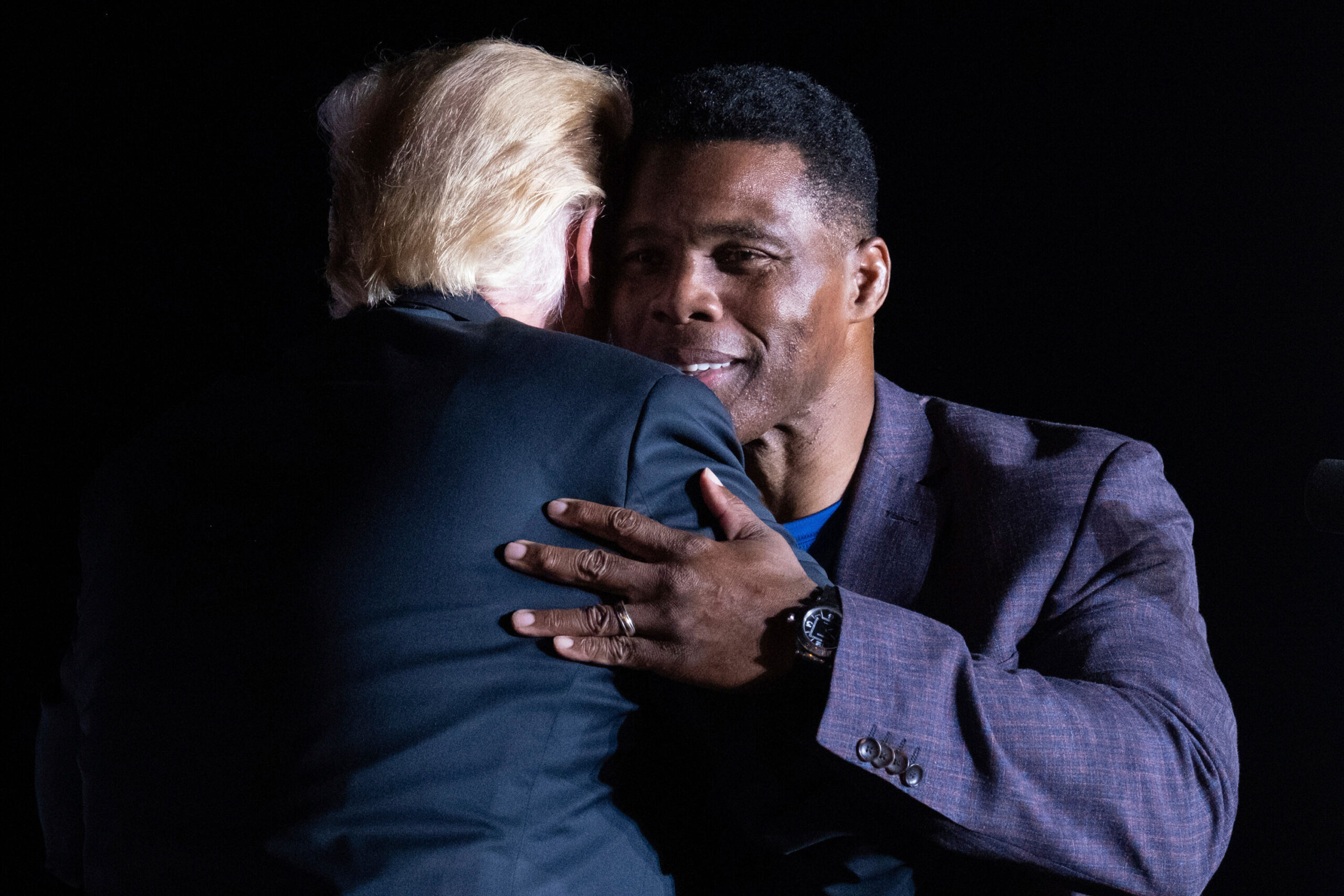 <i>Ben Gray/AP</i><br/>Former President Donald Trump hugs Georgia Senate candidate Herschel Walker during his Save America rally in Perry