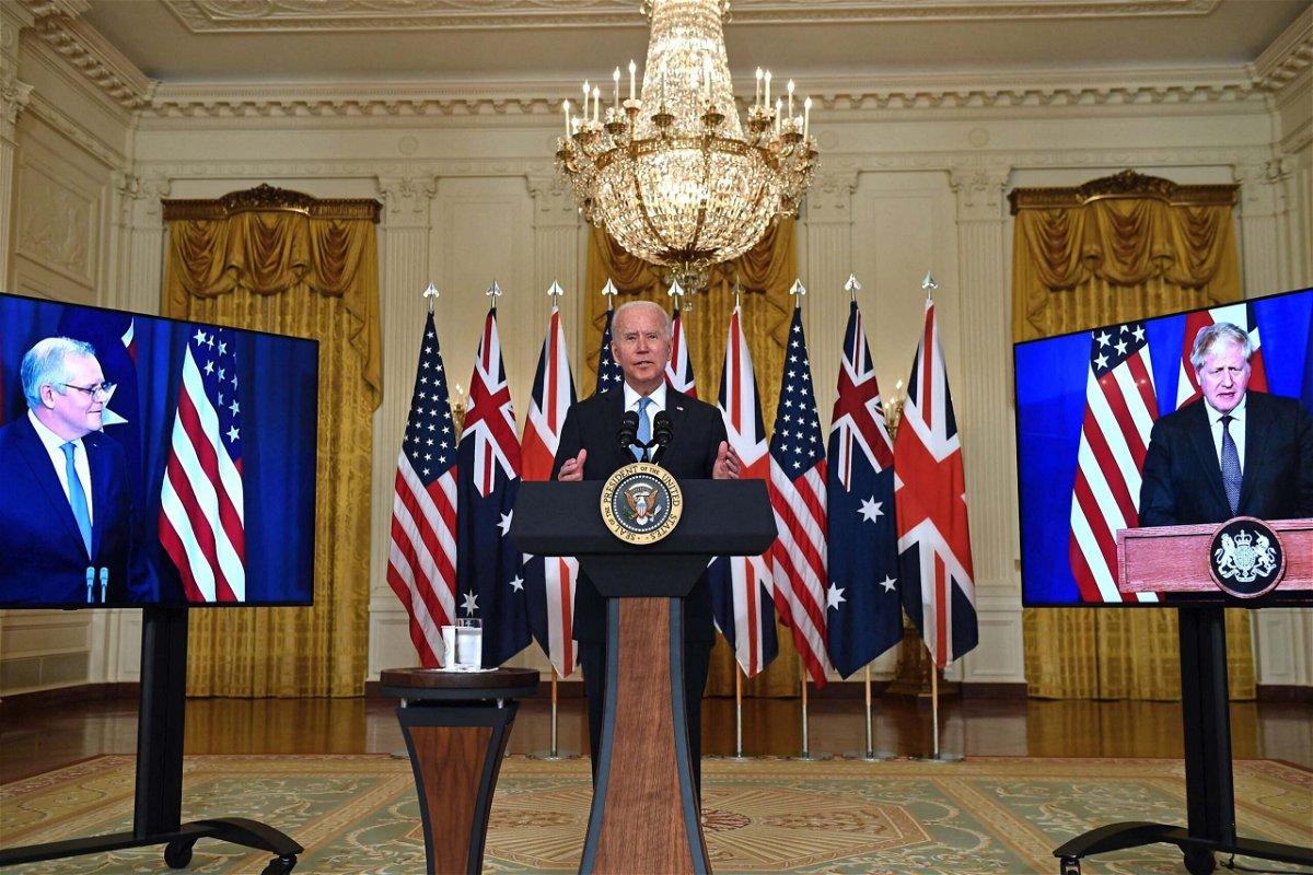 <i>Brendan Smialowski/AFP/Getty Images</i><br/>President Joe Biden speaks on national security with British Prime Minister Boris Johnson (L) and Australian Prime Minister Scott Morrison (R) at the White House in Washington