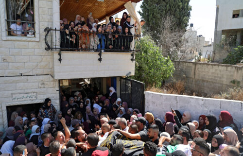 Mourners carry the body of Osama Sobh