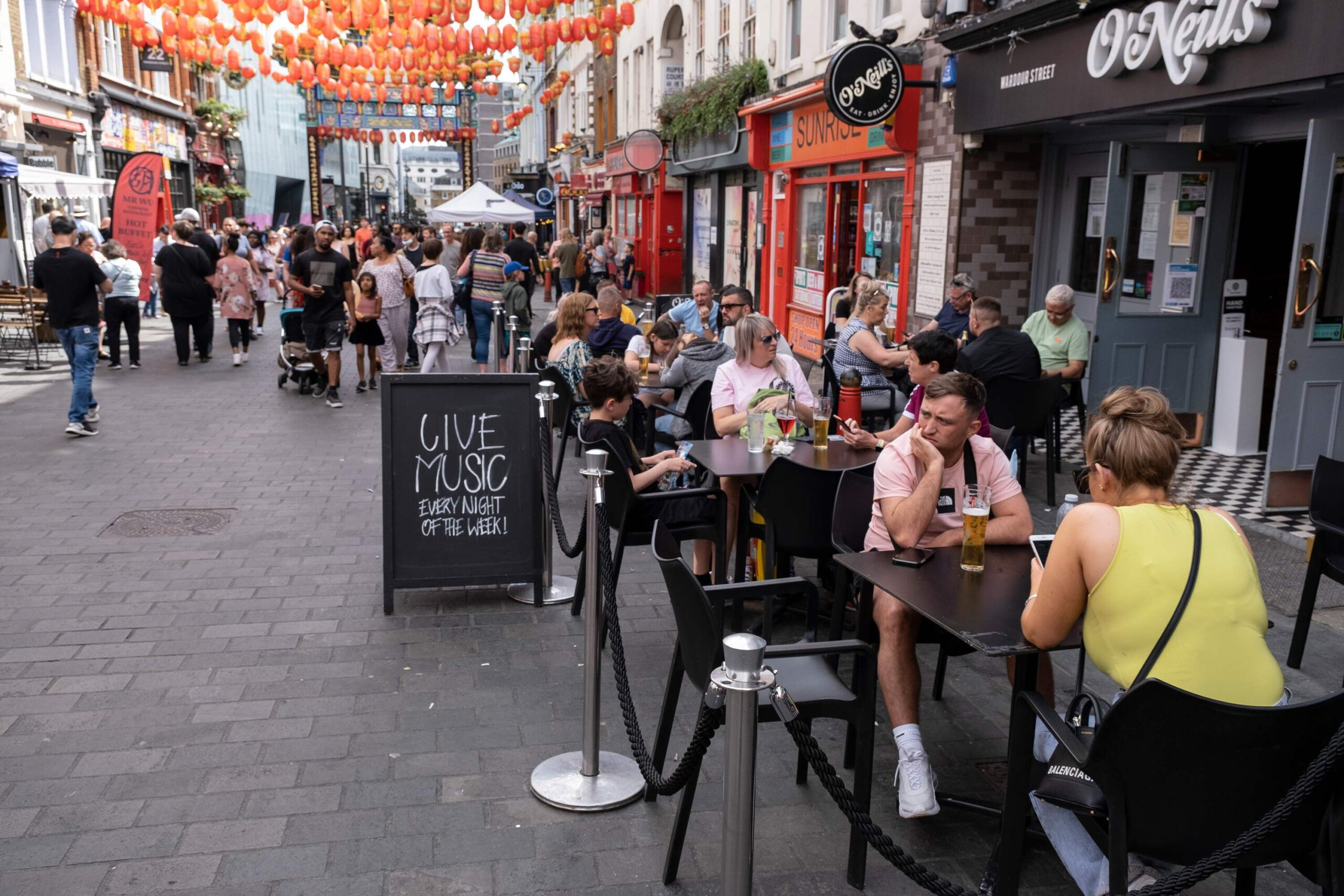 <i>Mike Kemp/In Pictures/Getty Images</i><br/>UK inflation spikes at a record rate in August. This image from August 10 shows restaurant diners in London's Chinatown.