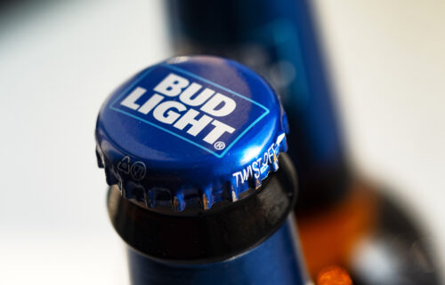 A Bud Light beer bottle is seen displayed in a store.