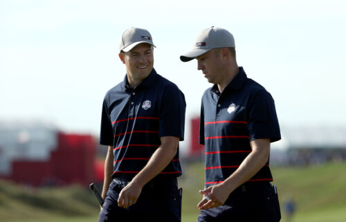 Jordan Spieth and Thomas walk during Friday Morning Foursome Matches of the 43rd Ryder Cup.