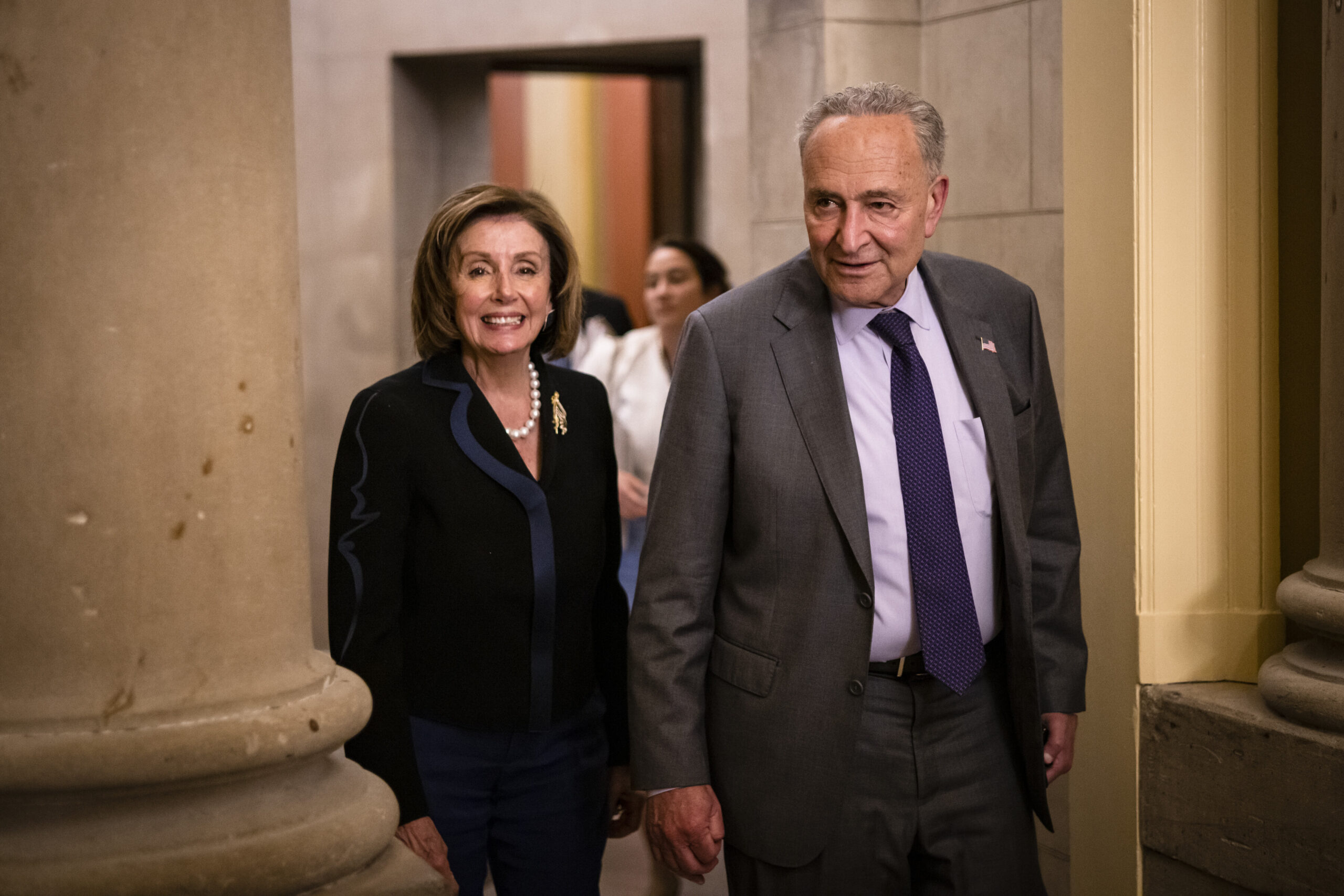 <i>Samuel Corum/Getty Images</i><br/>US Speaker of the House Nancy Pelosi (D-CA) and U.S. Senate Majority Leader Chuck Schumer (D-NY) emerge from the Speakers office after a bipartisan group of Senators and White House officials came to an agreement over the Biden administrations proposed infrastructure plan.