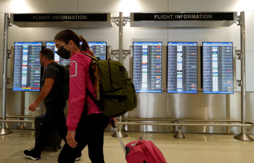 Travelers make their way through the Miami International Airport before starting the Labor Day weekend on September 3 in Miami