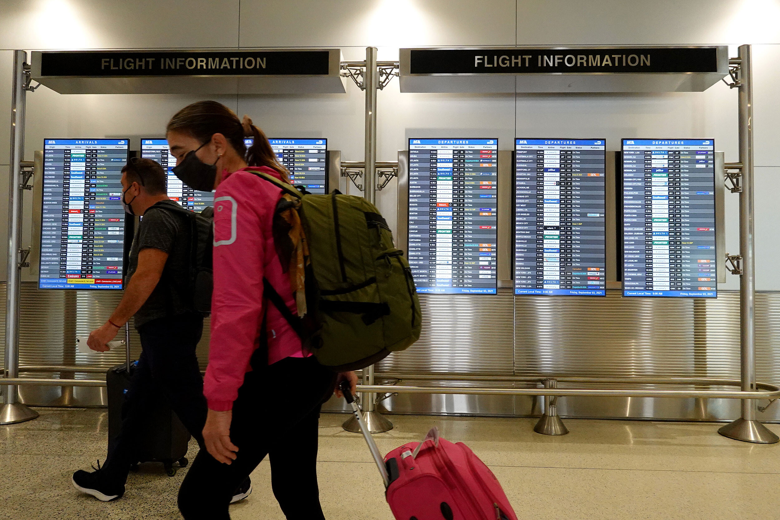<i>Joe Raedle/Getty Images</i><br/>Travelers make their way through the Miami International Airport before starting the Labor Day weekend on September 3 in Miami